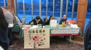 IU Chinese Calligraphy Club's table and the Center for the Study of the Middle East's table