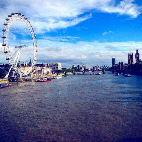 The London Eye and Houses of Parliament dominate the west end of the River Thames.