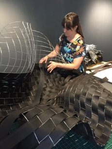 Weaving the black tar paper